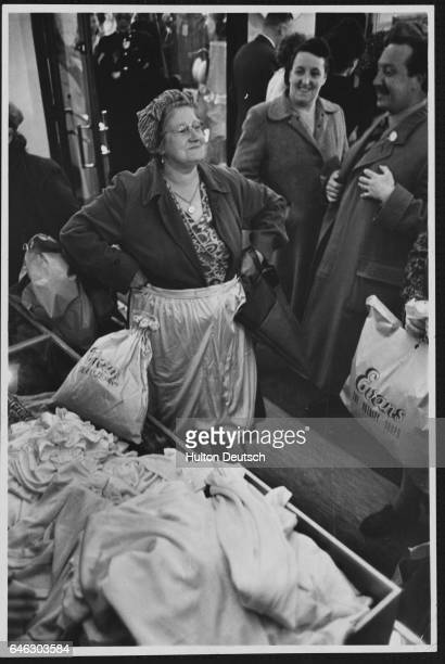 A bargain hunter measures bloomers up for size at the opening sale of an Evans clothing store which caters for the larger woman