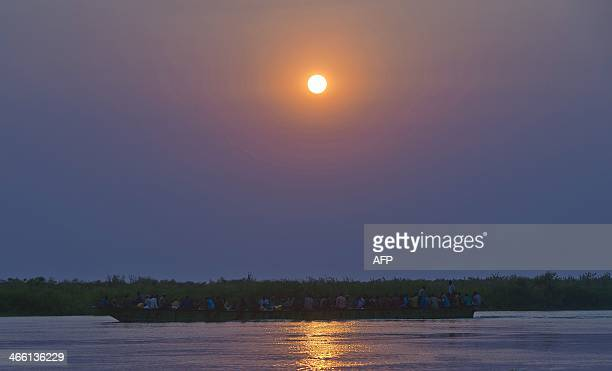 A barge carries people down the river Nile from Bor on January 30 2014 Recent fighting in the country has seen waves of brutal revenge attacks as...