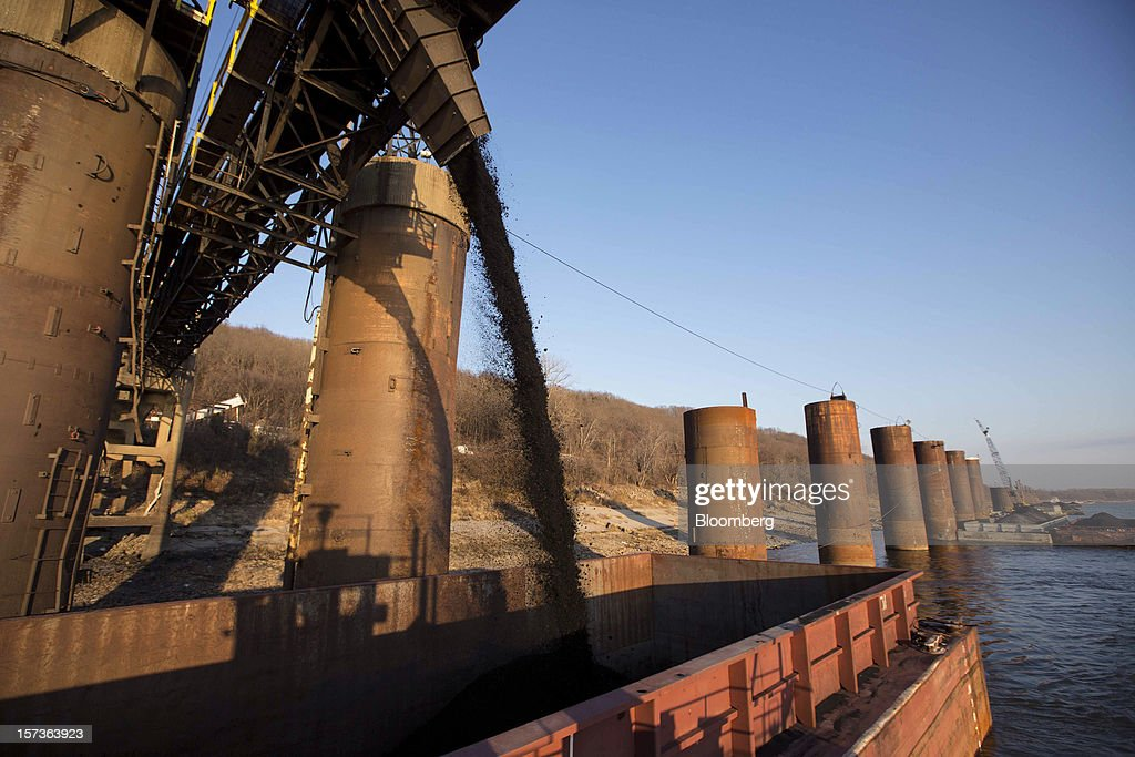 A barge is filled with coal along the Mississippi River at Knight Hawk Coal LLC in Chester, Illinois, U.S., on Friday, Nov. 30, 2012. The family-owned Knight Hawk employs 400 people and has another 300 contractors, including about 140 truck drivers. The company has never had layoffs since it opened in 1998, said Andrew Carter, vice president of sales and distribution. A blocked Mississippi could change that. Photographer: Whitney Curtis/Bloomberg via Getty Images