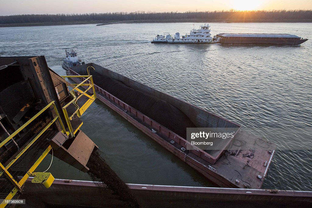 A barge is filled with coal as other barges move along the Mississippi River at Knight Hawk Coal LLC in Chester, Illinois, U.S., on Friday, Nov. 30, 2012. The family-owned Knight Hawk employs 400 people and has another 300 contractors, including about 140 truck drivers. The company has never had layoffs since it opened in 1998, said Andrew Carter, vice president of sales and distribution. A blocked Mississippi could change that. Photographer: Whitney Curtis/Bloomberg via Getty Images