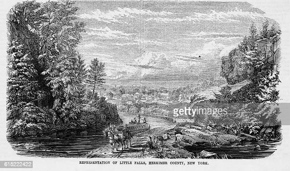 A barge is pulled by a mule team along a canal near Little Falls in Herkimer County New York