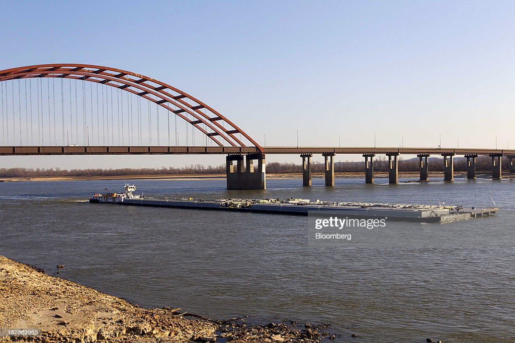 A barge makes its way down the Mississippi River in St. Louis, Missouri, U.S., on Friday, Nov. 30, 2012. The rush is on to keep customers supplied, workers employed and commerce alive in communities that rely on the nation's busiest waterway. The usual dry season, combined with the worst drought in 50 years, may push water levels so low in coming weeks it will halt traffic in a section south of St. Louis, near the river's midpoint. Photographer: Whitney Curtis/Bloomberg via Getty Images