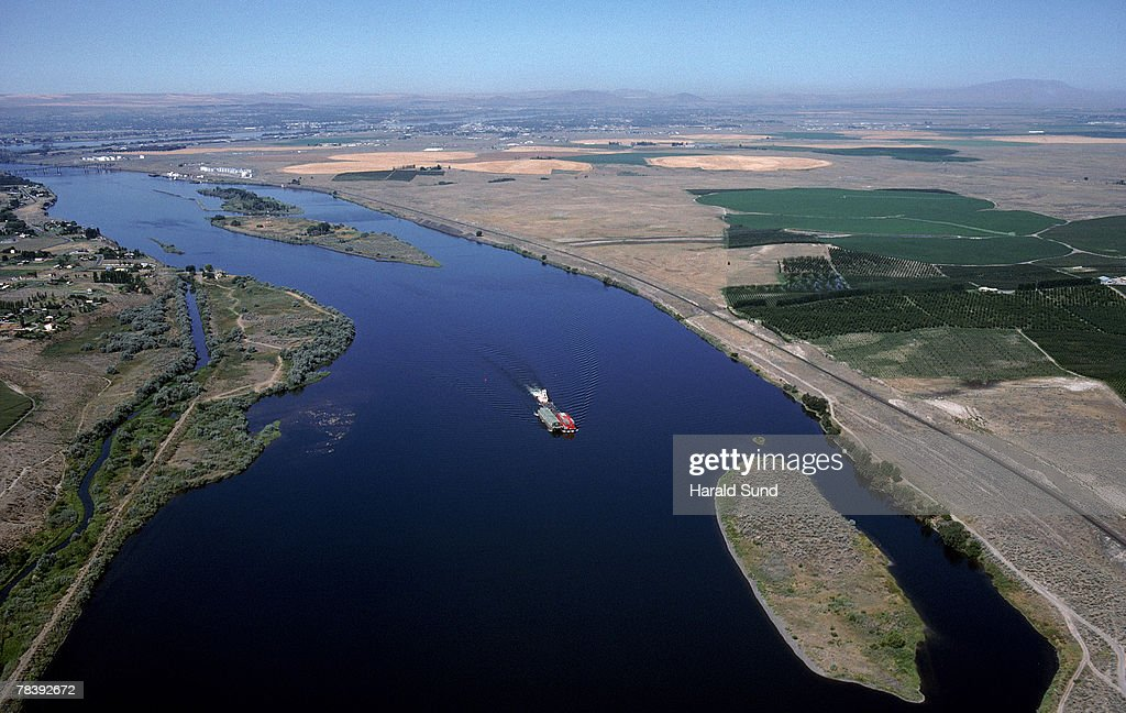 Barge on river : Stock Photo