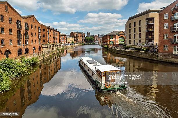 Barge sailing into Leeds, England, UK