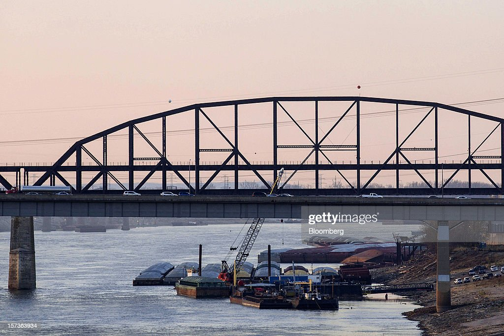 Barges float along the banks of the Mississippi River near downtown St. Louis, Missouri, U.S., on Friday, Nov. 30, 2012. The rush is on to keep customers supplied, workers employed and commerce alive in communities that rely on the nation's busiest waterway. The usual dry season, combined with the worst drought in 50 years, may push water levels so low in coming weeks it will halt traffic in a section south of St. Louis, near the river's midpoint. Photographer: Whitney Curtis/Bloomberg via Getty Images