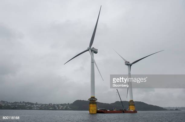 Barges position offshore floating wind turbines during assembly in the Hywind pilot park operated by Statoil ASA in Stord Norway on Friday June 23...