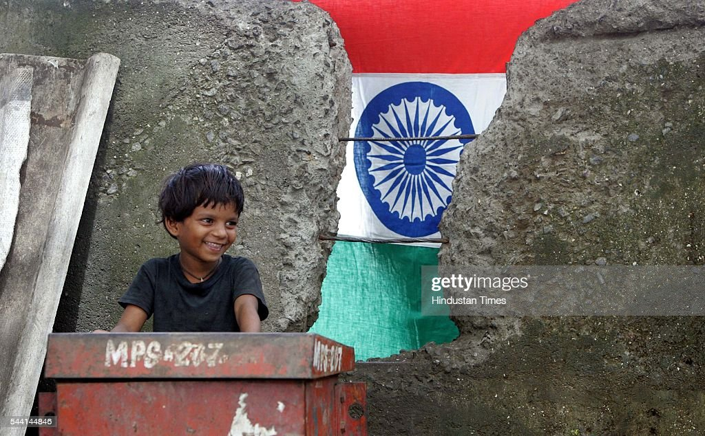 Bargirls 10year old JYOTI bansode smiles on the background of Indian Tricolour.