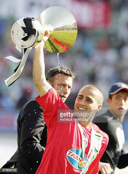 Juventus defender Fabio Cannavaro raises the championship cup after winning against Reggina at the end of their Italian serie A football match at San...