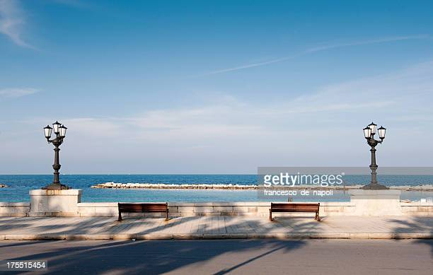 Bari, promenade with bench and lamppost. Apulia - Italy