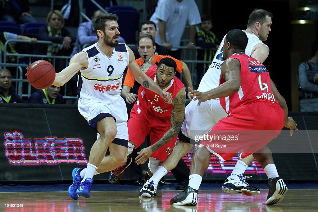 Baris Ermis #9 of Fenerbahce Ulker competes with Kyle Hines #4 and <a gi-track='captionPersonalityLinkClicked' href=/galleries/search?phrase=Acie+Law&family=editorial&specificpeople=801584 ng-click='$event.stopPropagation()'>Acie Law</a> #5 of Olympiacos Piraeus during the 2012-2013 Turkish Airlines Euroleague Top 16 Date 13 between Fenerbahce Ulker Istanbul v Olympiacos Piraeus at Fenerbahce Ulker Sports Arena on March 29, 2013 in Istanbul, Turkey.