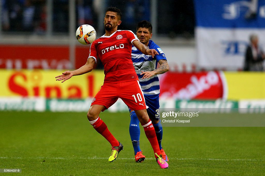 Baris Oezbek of Duisburg (R) challenges Kerem Demirbay of Duesseldorf (L) during the 2. Bundesliga match between MSV Duisburg and Fortuna Duesseldorf at Schauinsland-Reisen-Arena on April 29, 2016 in Duisburg, Germany.