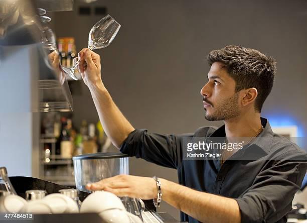 barista arranging wine glasses
