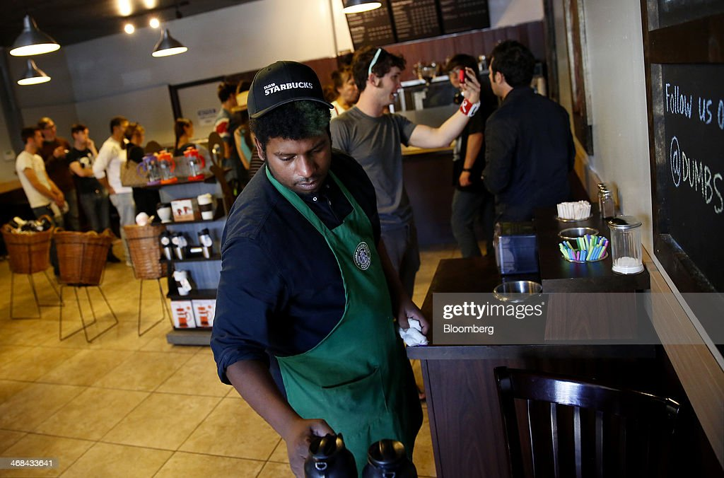 A barista cleans a counter at the Dumb Starbucks Coffee store, a parody of the Starbucks Corp. coffee chain, in Los Angeles, California, U.S., on Monday, Feb. 10, 2014. Dumb Starbucks, which opened this past weekend, offered Dumb Vanilla Blonde Roast, Dumb Chai Tea Latte, and Dumb Caramel Macchiato, all available in sizes Dumb Venti, Dumb Grande, and Dumb Tall. Photographer: Patrick T. Fallon/Bloomberg via Getty Images
