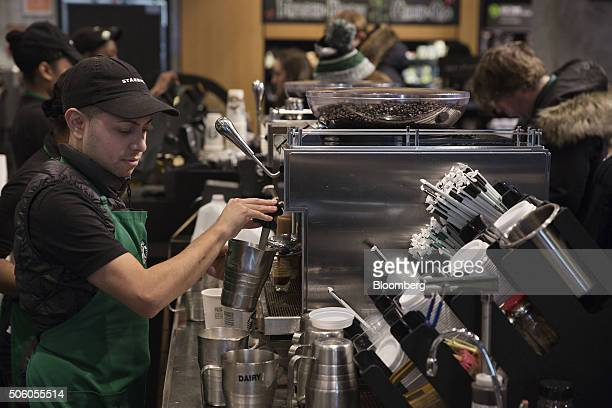 A barista froths milk for a drink inside a Starbucks Corp coffee shop in New York US on Monday Jan 18 2016 Starbucks Corp is scheduled to release its...