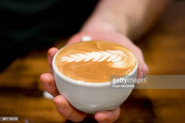 Barista Holding Latte
