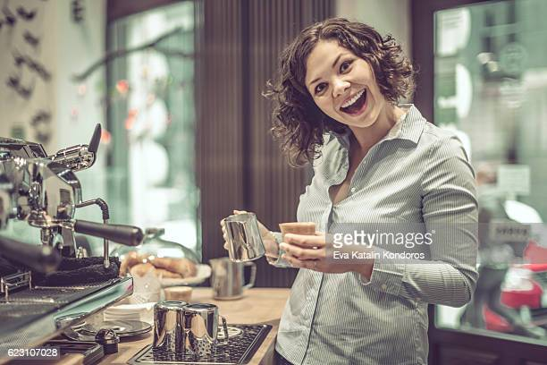 Barista is making a coffee
