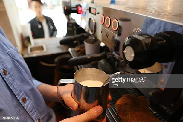 A barista makes coffee in a 2squaremeter cafe named Manner Coffee stands at Nanyang Road on June 4 2016 in Shanghai China The shopkeeper Han Yulong...