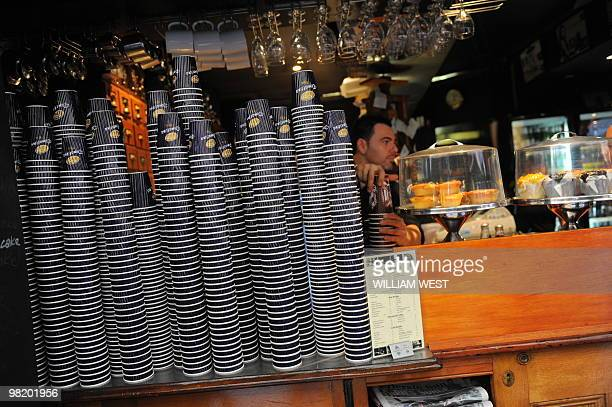A Barista makes coffee in one of Melbourne's innercity laneways which is home to many vibrant bars cafes restaurants boutiques sushi bars and shops...