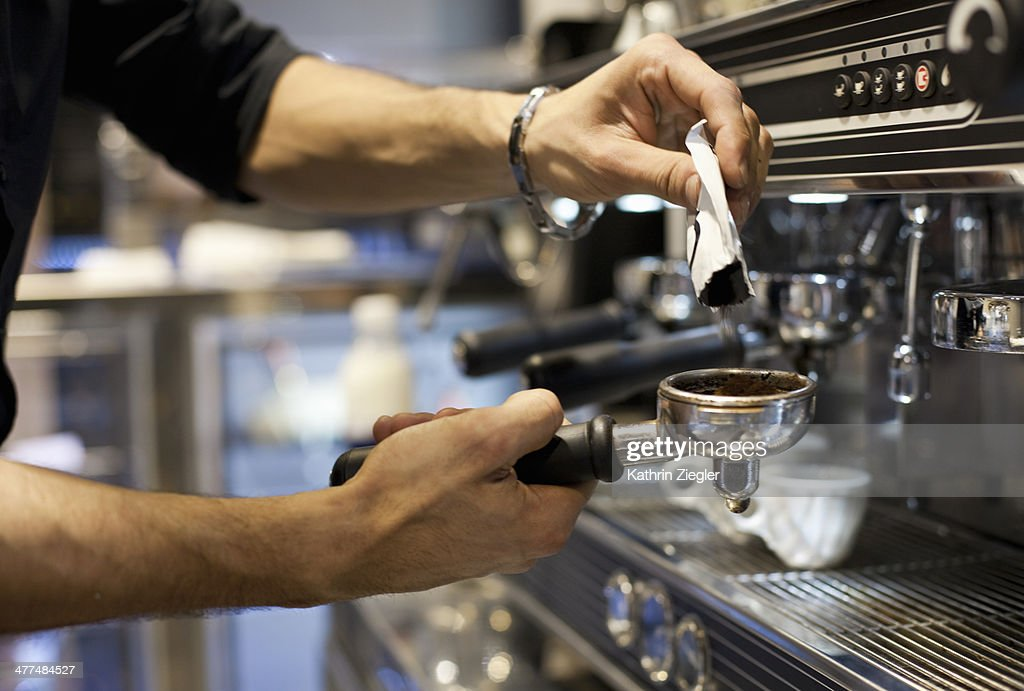barista making coffee, close-up of hands
