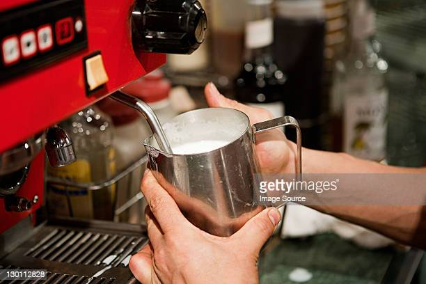 Barista making coffee in cafe