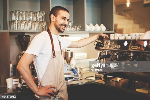 Barista making coffee using a coffee maker