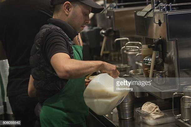 A barista pours milk into a drink at a Starbucks Corp coffee shop in New York US on Monday Jan 18 2016 Starbucks Corp is scheduled to release its...