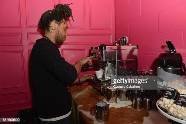 A barista prepares a drink at the Lavazza Coffee Moment At NYFW VIP Lounge Cafe at Skylight Clarkson Sq on February 10 2017 in New York City