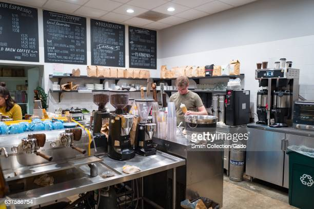 A barista prepares an espresso drink inside Coffee Shop a trendy coffee shop in downtown Walnut Creek California December 3 2016 Gourmet coffee shops...
