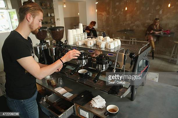 A barista prepares coffee from an Italian espresso machine at Bonanza Coffee cafe in Prenzlauer Berg district on May 4 2015 in Berlin Germany Berlin...