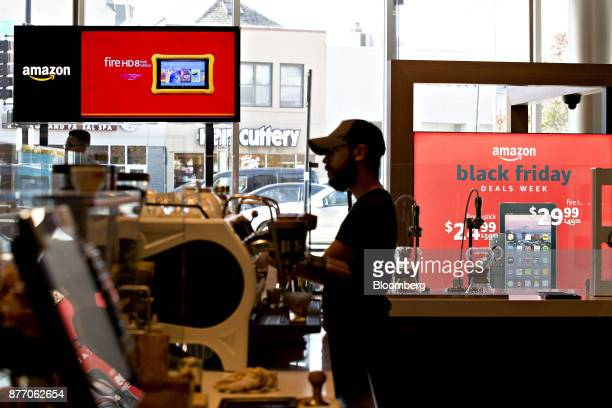 A barista prepares coffee in front of an Amazoncom Inc PopUp store inside the Lakeview Whole Foods Market Inc store in Chicago Illinois US on Monday...