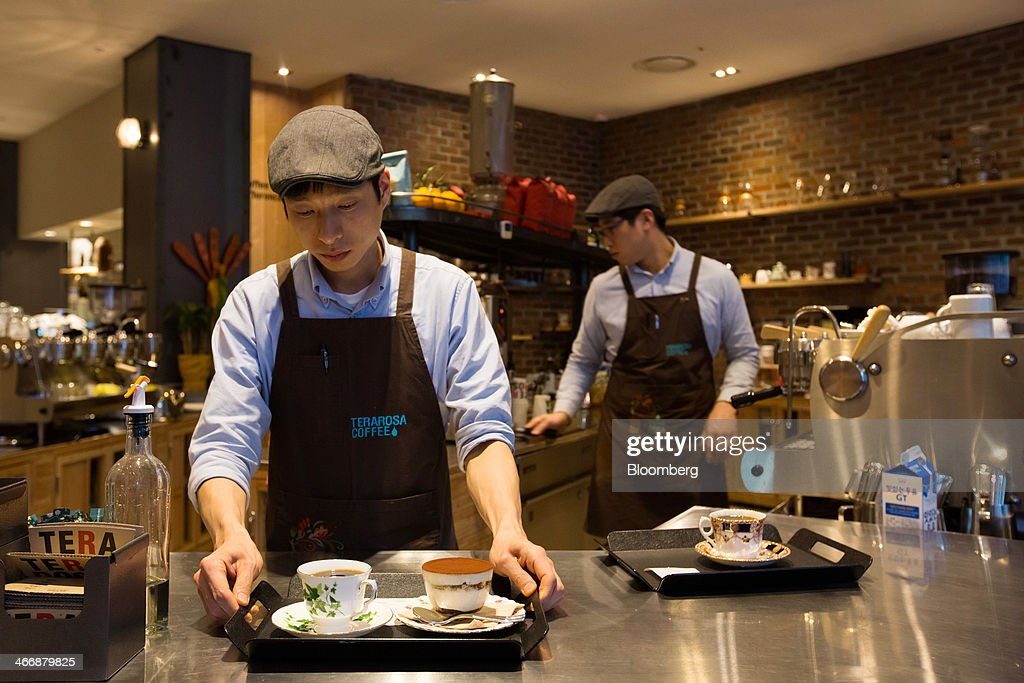 A barista prepares coffee to be served at the Terarosa Coffee shop in Seoul, South Korea, on Tuesday, Feb. 4, 2014. South Korea is Asias fastest-growing market for arabica coffee, the mild-tasting beans used in premium blends. Photographer: SeongJoon Cho/Bloomberg via Getty Images