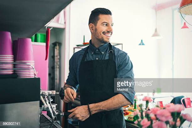 Barista preparing coffee in cafe