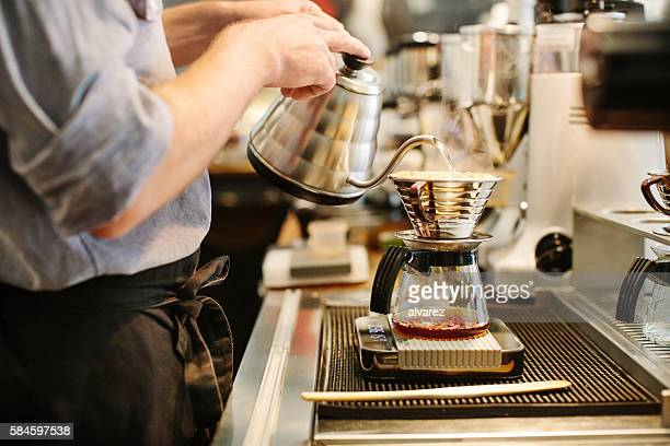 Barista preparing drip coffee