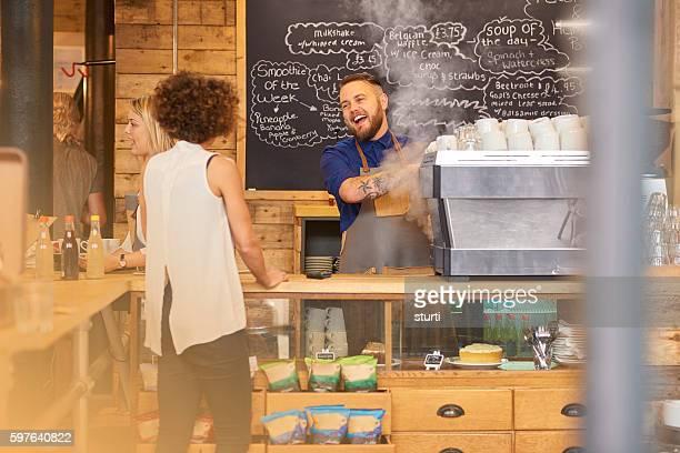 Barista sharing a joke with customer