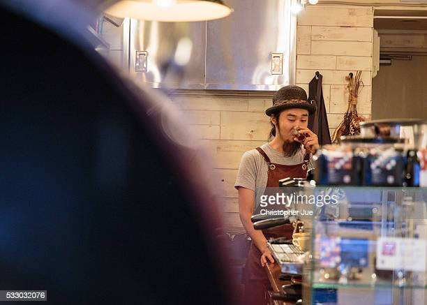 Barista Takaya Hashimoto takes a sip of coffee at a local specialty coffee shop on May 20 2016 in Tokyo Japan With the rise of specialty coffee shops...