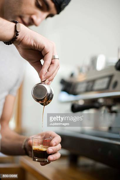 Barista working at espresso bar