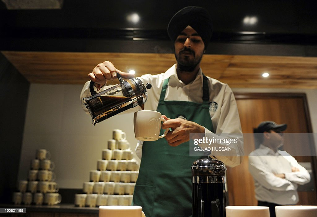 A barista works behind the counter at the newly-inaugurated Starbucks outlet in New Delhi on February 6, 2013. Starbucks, the world's biggest coffee chain, launched its first outlet in New Delhi on Wednesday with an aim to expand its reach to customers across India.