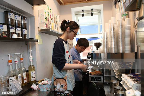 Baristas make coffee in a 2squaremeter cafe named Manner Coffee stands at Nanyang Road on June 4 2016 in Shanghai China The shopkeeper Han Yulong and...