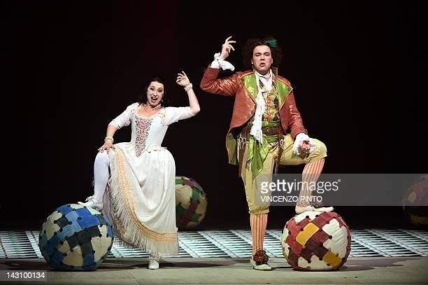 Baritone Alessandro Luongo as Figaro and soprano Annalisa Stroppa as Rosina perform during the dress rehearsal of Gioacchino Rossini's opera ' Il...