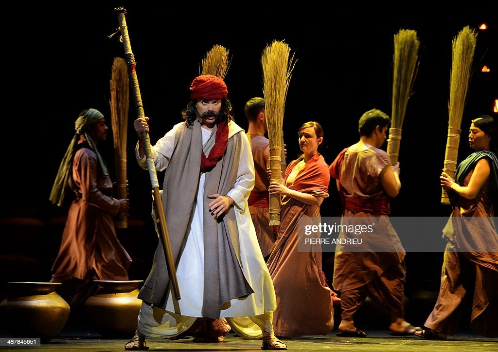Baritone Franco Pomponi (Front) performs during a full dress rehearsal of the Opera 'A Flowering Tree' at the Chatelet theater on May 2, 2014 in Paris. The Opera by composer John Adams and staged by Indian director and screenwriter Vishal Bhardwaj, is inspired by a southern Indian folk tale describing the trials and tribulations of a young couple to demonstrate the power of love. It shows through May 5 - 13, 2014 at the Chatelet theater in Paris.