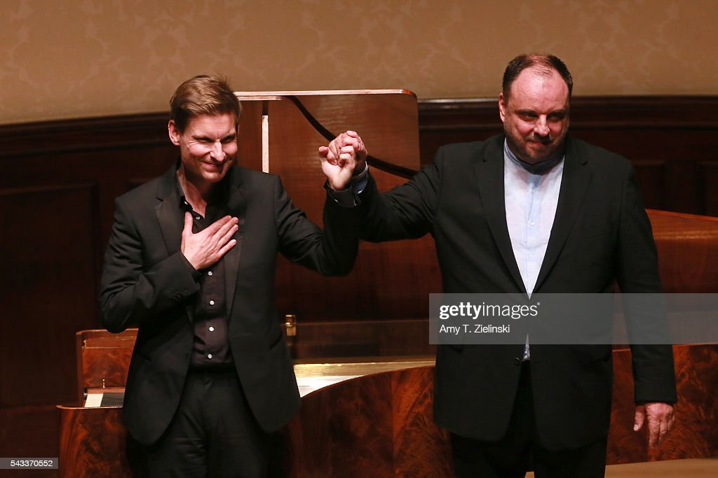 Baritone Matthias Goerne and pianist Kristian Bezuidenhout (L) grab hands to receive the audience after presenting six songs of 'An die ferne Geliebte' together with a selection of other songs by composer Beethoven at Wigmore Hall on June 27, 2016 in London, England.