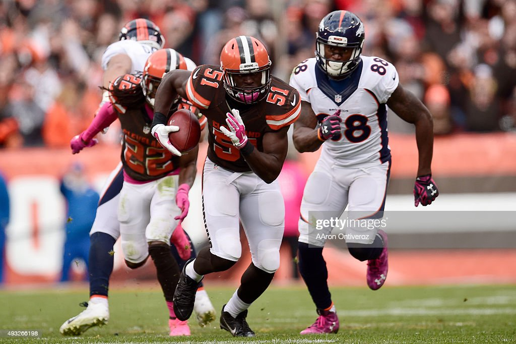 Barkevious Mingo of the Cleveland Browns intercepts Peyton Manning of the Denver Broncos on the first possession of overtime as Demaryius Thomas...