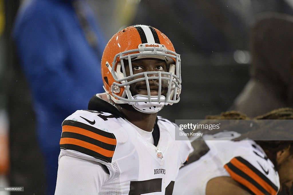 Barkevious Mingo of the Cleveland Browns sits on the bench during the fourth quarter against the Green Bay Packers at Lambeau Field on October 20...