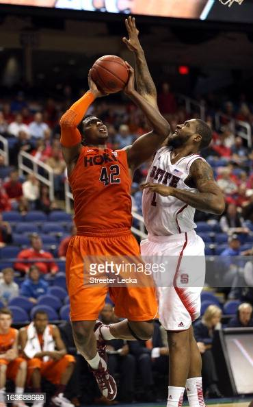 J Barksdale of the Virginia Tech Hokies drives to the basket against Richard Howell of the North Carolina State Wolfpack during the first round of...