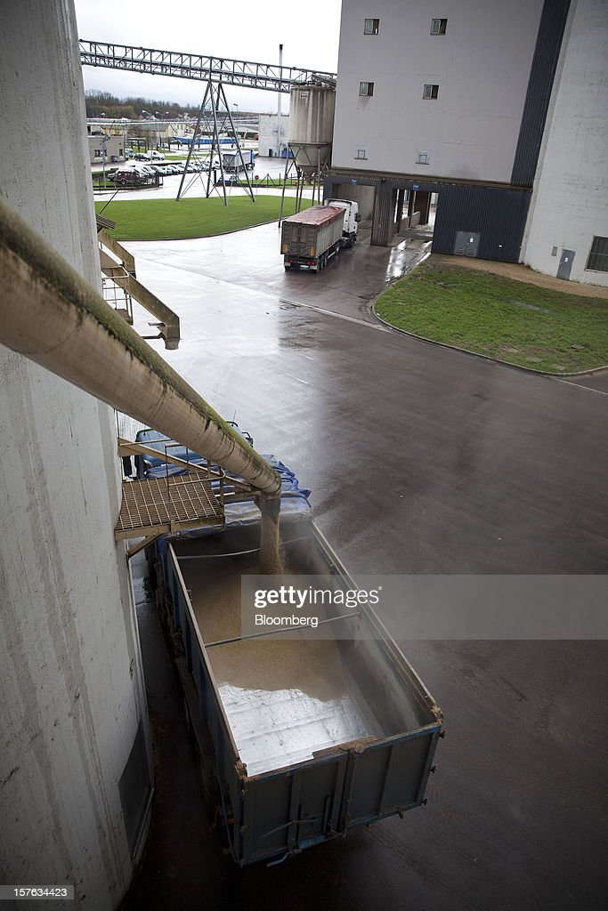 Barley grain pours from a silo into a delivery truck at the Groupe Soufflet plant in Nogent-sur-Seine, France, on Tuesday, Dec. 4, 2012. European Union corn imports may be the second-highest on record this season after drought parched crops and a surge in wheat exports curbed domestic grain supply. Photographer: Balint Porneczi/Bloomberg via Getty Images