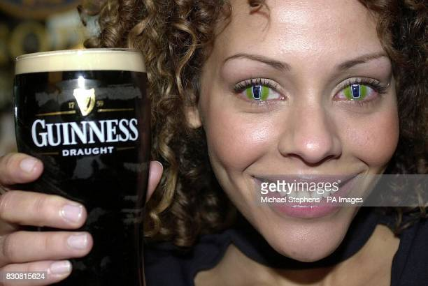 Barmaid Donna Ladd from London wearing specially designed contact lenses advertising the drink Guinness at The O'Conor Don pub in Marylebone London...