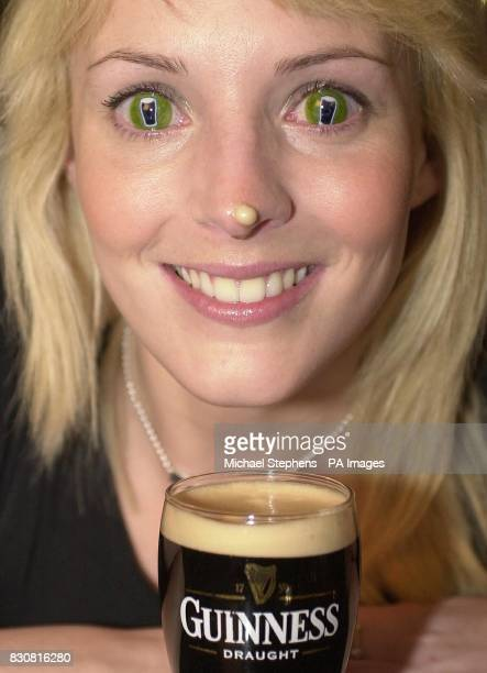 Barmaid Jo Hicks from London wearing specially designed contact lenses advertising the drink Guinness at The O'Conor Don pub in Marylebone London...