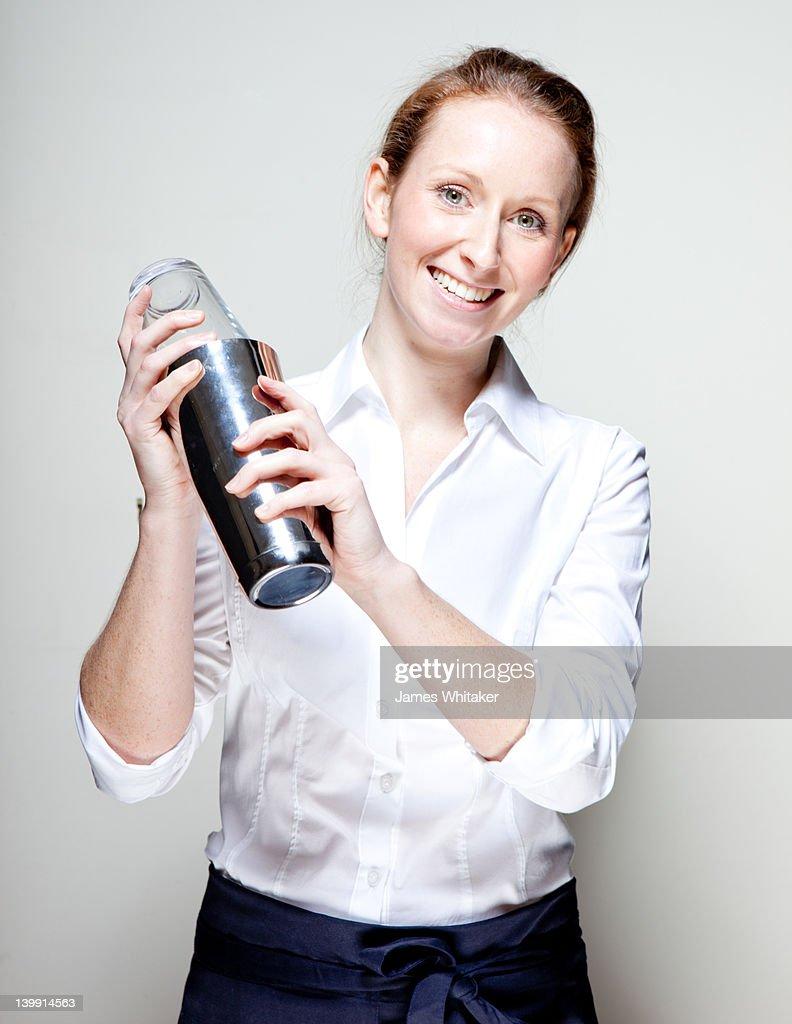 Barmaid shakes cocktail : Stock Photo