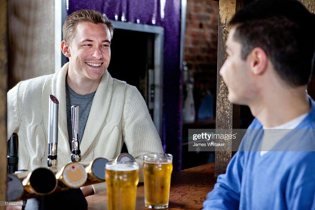 Barman and punter : Stock Photo