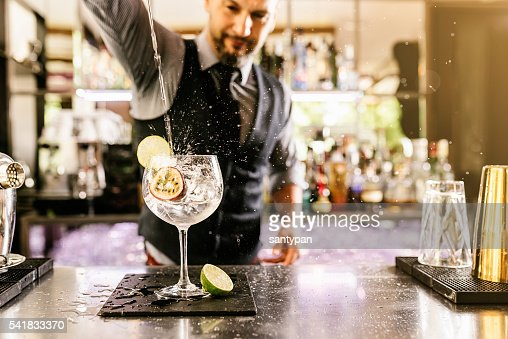 Barman is making cocktail at night club. : Photo